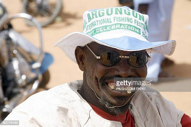 A handicapped man smiles as he welcomes guests to Argungu in Kebbi State northwestern Nigeria for the Argungu fishing festival on March 13 2008...