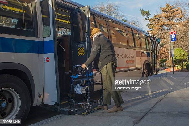 Handicapped man with walker boarding bus