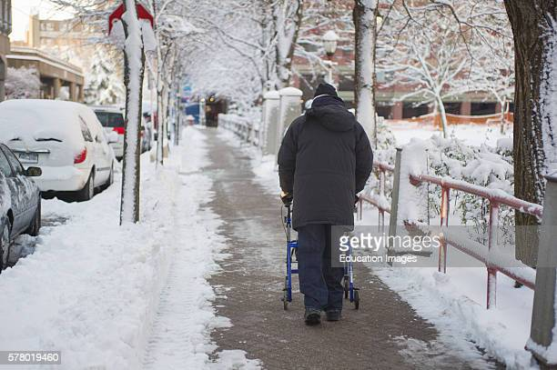 Handicapped Man With Walker Out For Stroll