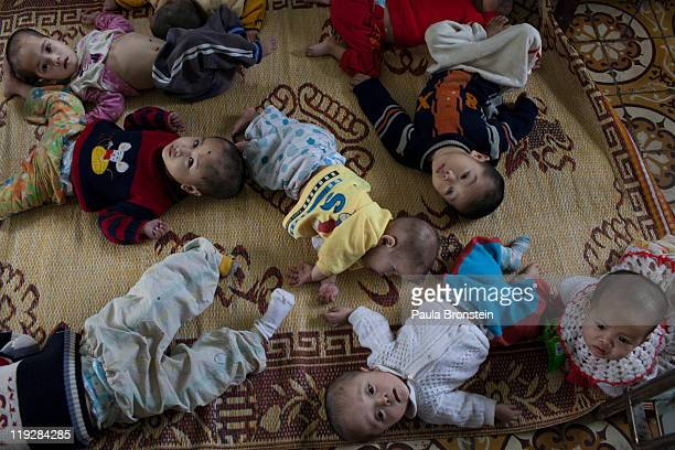 Handicapped orphans lay on the floor waiting for their turn to be bathed by the medical staff at the Ba Vi orphanage March 15 in Ba Vi Vietnam There...