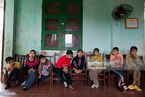Handicapped orphans sit in their chairs waiting for lunch at the Ba Vi orphanage March 15 in Ba Vi Vietnam There are around 125 children who are...