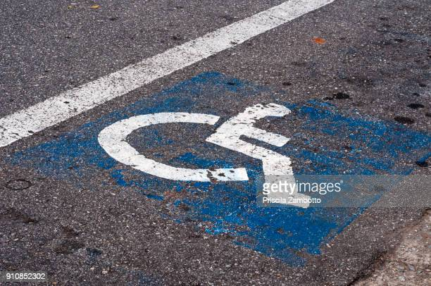 handicapped parking space - disabled sign stock photos and pictures