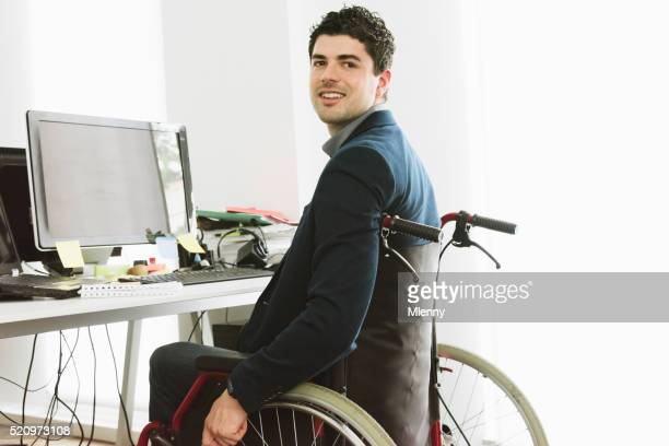 Handicapped software engineer at office desk