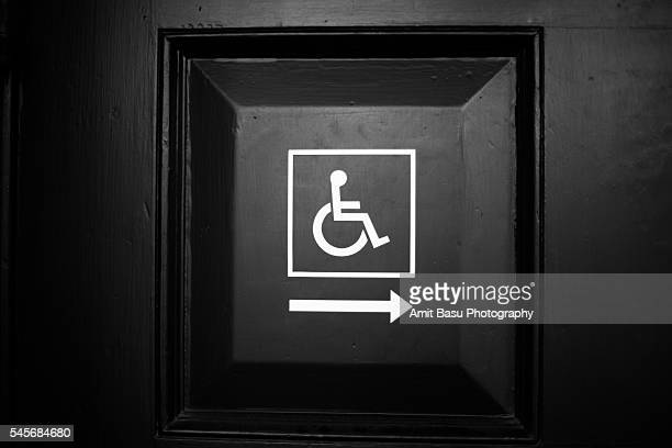 handicapped wheelchair access sign on dooor - detour sign stock photos and pictures