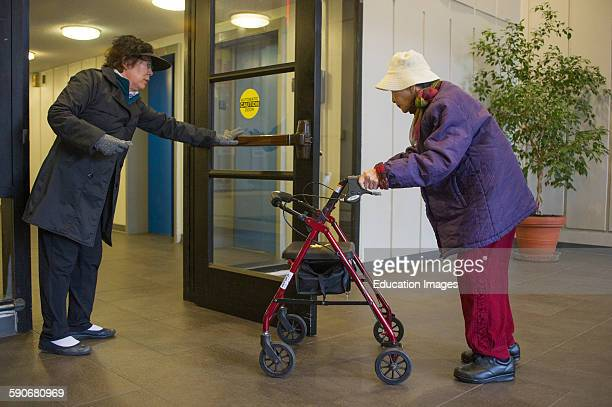 Handicapped woman with walker entering building