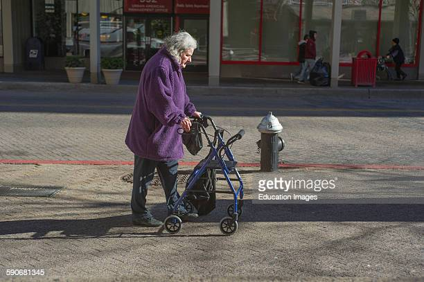 Handicapped woman with walker out for stroll