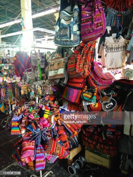 handicraft at mercado central de san pedro in cuzco, peru - kunst und handwerkserzeugnis stock-fotos und bilder
