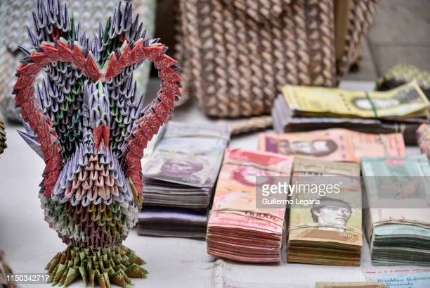 Handicraft made with Venezuelan devalued and out of circulation banknotes Bolivares Fuertes, is exhibited for sale by Colombian designer Luis Orlando...