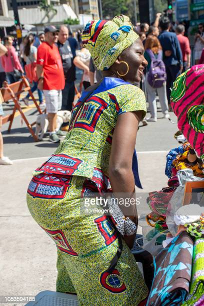 Handicraft seller - cultural events at Avenida Paulista, São Paulo, Brazil.
