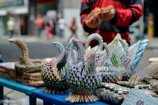 Handicrafts made with Bolivar bills are displayed for sale in a street of Cucuta, Colombia, on the border with Venezuela, on February 20, 2019. - The...