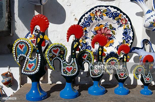 Handicrafts on sale majolica roosters symbol of Portugal Obidos Portugal