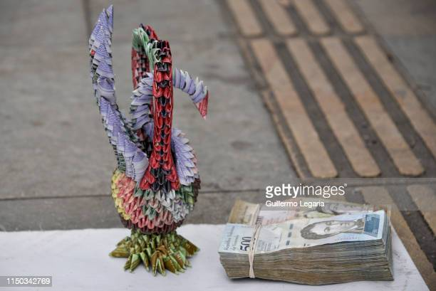 Handicrafts swan made with Venezuelan devalued and out of circulation banknotes Bolivares Fuertes are exhibited for sale by Colombian designer Luis...