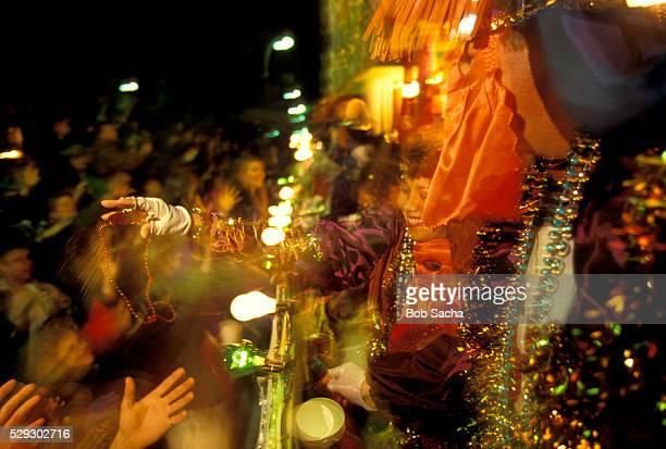 handing out beads at mardi gras - gras bildbanksfoton och bilder