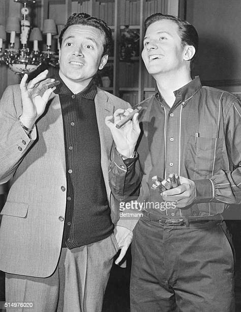 Handing out cigars is Pat Boone who became a papa for the fourth time January 30th. On hand to congratulate him is Vic Damone. The 7 pound 12 once...