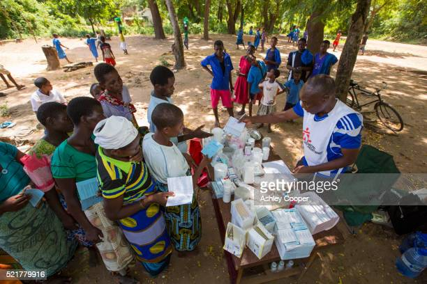 Handing out Malaria drugs to flood victims in Malawi.