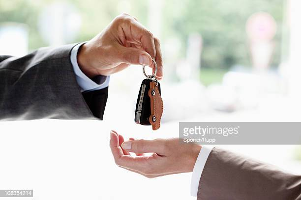handing over key - car salesperson stock pictures, royalty-free photos & images