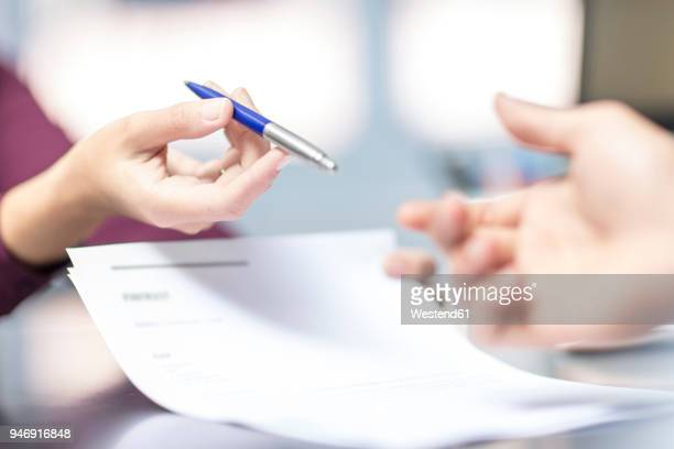 handing over of a pen over document - endorsing stock pictures, royalty-free photos & images
