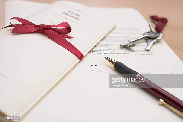 handing over the title deeds - deed stock photos and pictures