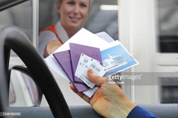 handing over tickets and passports to board boat - security stock pictures, royalty-free photos & images