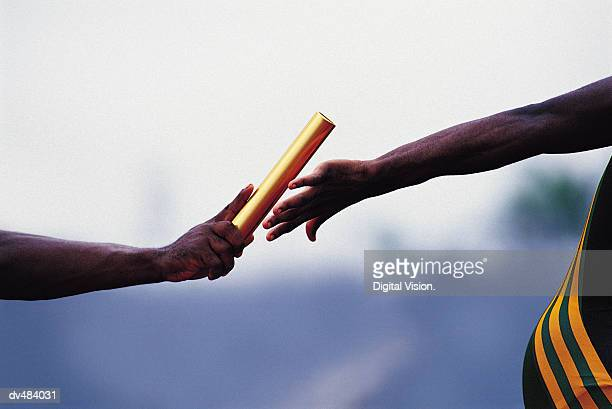 handing the baton - relay stock pictures, royalty-free photos & images