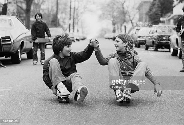 Handinhand a couple skates Michael Anastasic and Patricia Kiecka sail down a Brooklyn street on their skateboards as milder temperatures begin to...
