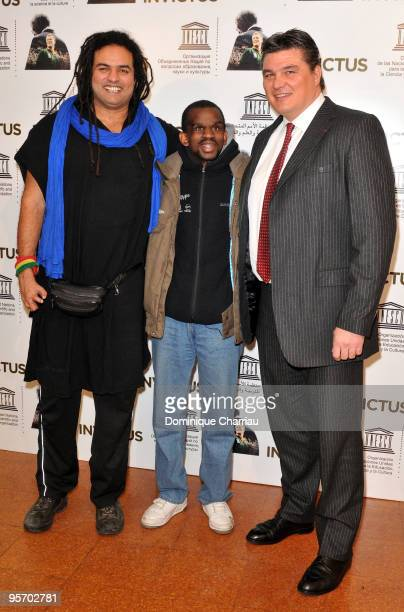 Handisport basketball player Ryad Sallem handisport athlete Aladji Ba and athlete David Douillet attend the Invictus Paris premiere at UNESCO on...