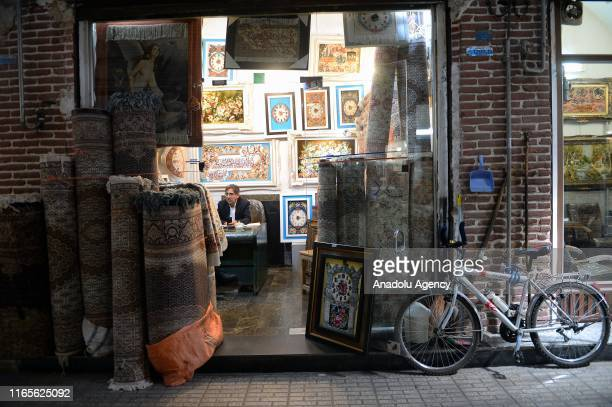 Hand-knotted carpet store is seen at a market in West Azerbaijan province's Hoy city of Iran on August 18, 2019. Handmade Persian rug industry takes...