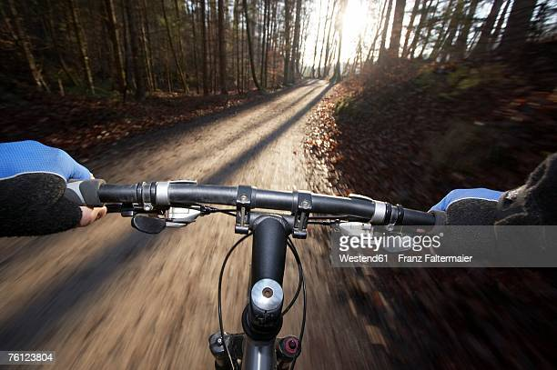 handle bar of driving mountain bike, blurred motion - handlebar stock photos and pictures