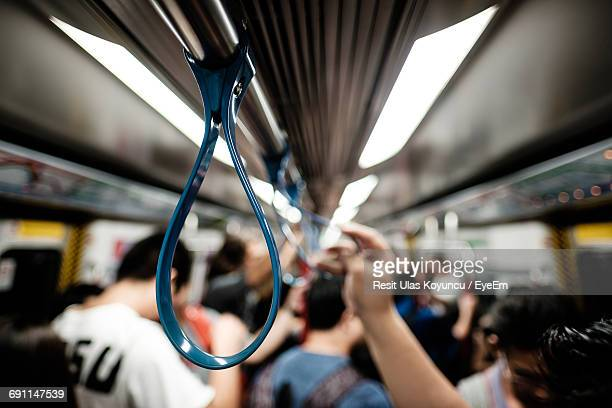 handle in crowded train - handle stock pictures, royalty-free photos & images