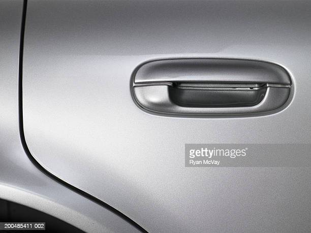 Handle on exterior of car door, close-up