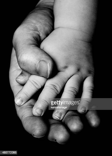 Handle with care, holding with love