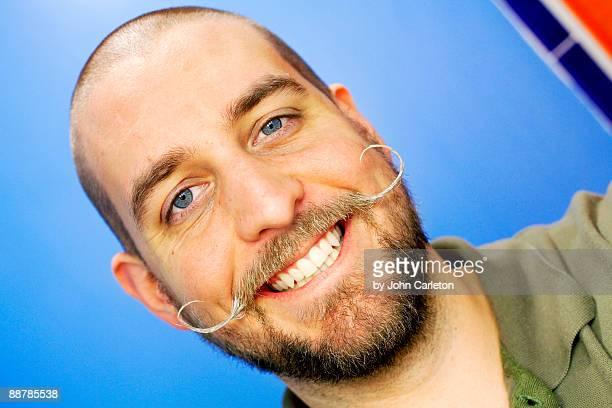Handlebar mustache smile