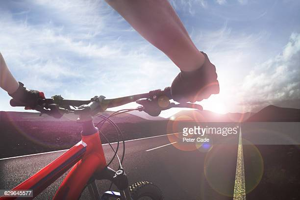 handlebar view of cyclist on open road