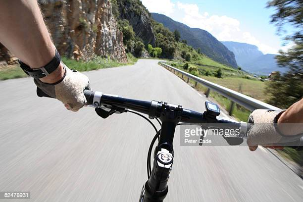 Handlebars of bike in mountain path