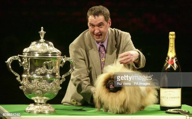 Handler Albert Easdon with threeyearold Pekinese dog called Danny after he was named Best in Show at the Centennial Crufts event at the NEC Birmingham