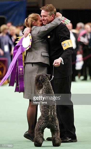 Handler Bill McFadden hugs owner Marilu Hansen after her Kerry blue terrier Torums Scarf Michael commonly known as Mick won the Best of Show award on...