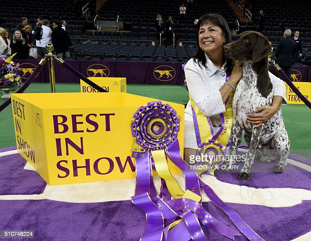 Handler Valerie NunesAtkinson embraces German shorthaired pointer named CJ after he won Best in Show of the 140th Annual Westminster Kennel Club Dog...