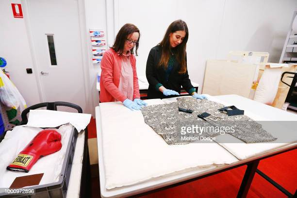 Handlers unveil a shirt worn by Nelson Mandela at Melbourne Museum on July 18 2018 in Melbourne Australia Mandela My Life The Official Exhibition...