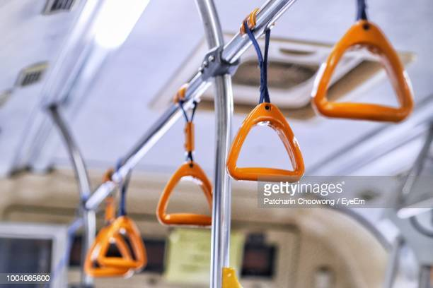 handles hanging in bus - handle stock pictures, royalty-free photos & images