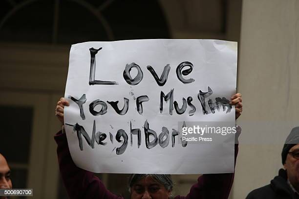 Handlettered Love Your Muslim Neighbor sign held aloft City council speaker Melissa MarkViverito led an interfaith rally of political leaders and...