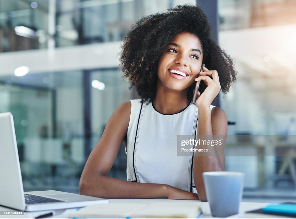 Handling her business one call at a time : Stock Photo