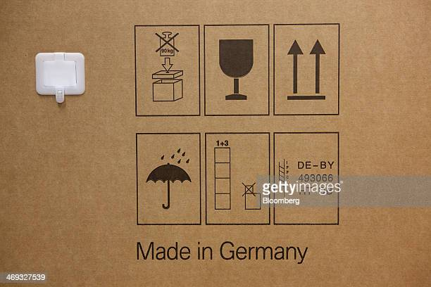 Handling instructions and Made in Germany sit on a cardboard box as motorbikes are prepared for shipping at the Bayerische Motoren Werke AG factory...