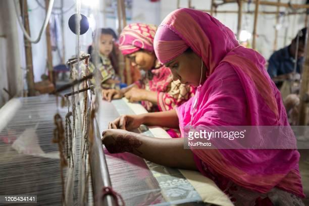 Handloom weaver weaves Jamdani saree on a traditional wooden hand weaving loom at Demra Jamdani Palli in Dhaka Bangladesh on March 06 2020