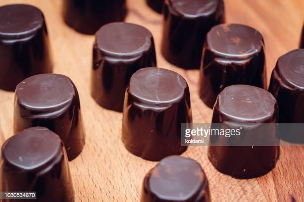 handmade artisan chocolate - chocolate pieces stock photos and pictures