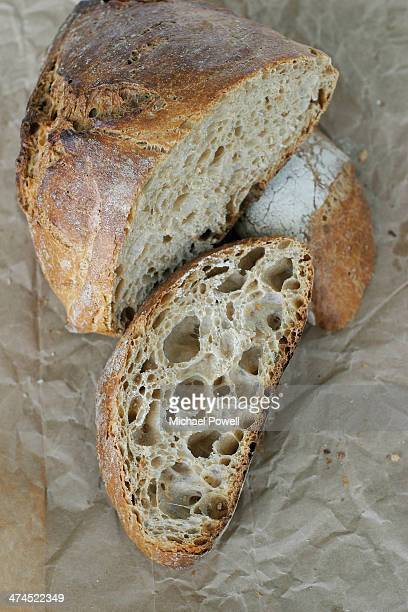 Handmade artisan French sour dough bread loaf on b