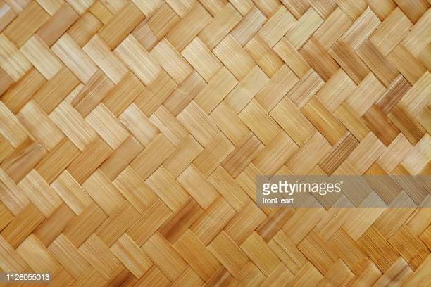 handmade bamboo background. - bamboo material stock photos and pictures
