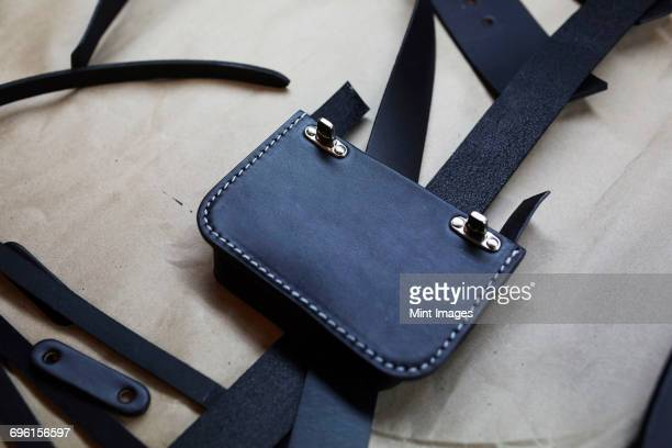 a handmade blue leather bag, strap, component part parts, scissors and hand tools. - stiches stock photos and pictures