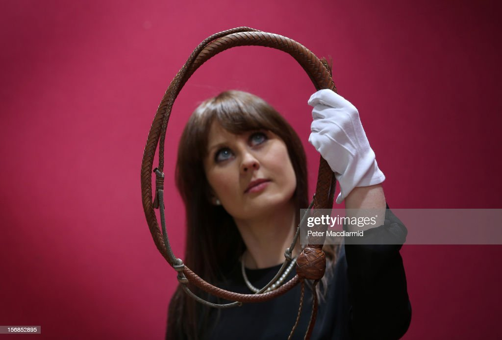 A hand-made bull-whip of kangaroo hide from the film Indiana Jones is shown at Christie's on November 23, 2012 in London, England. Estimated at £10000 - £15000 it forms part of Christie's Pop Culture sale on November 29 in London.