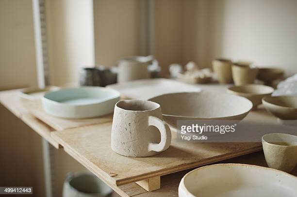 handmade ceramic works in studio - ceramics stock pictures, royalty-free photos & images