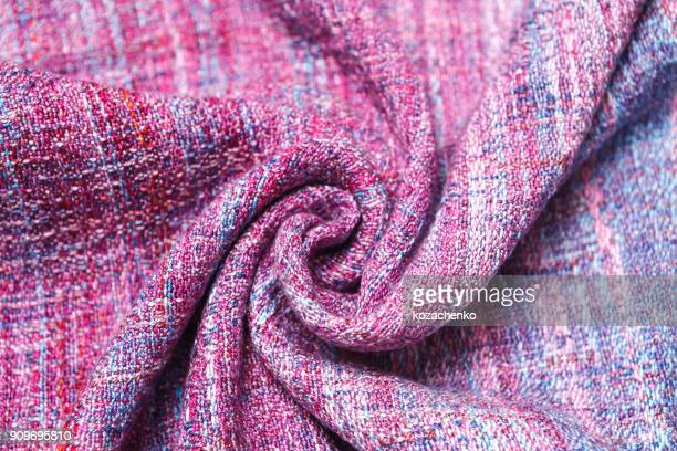 Handmade cloth with purple and lilac striped texture.